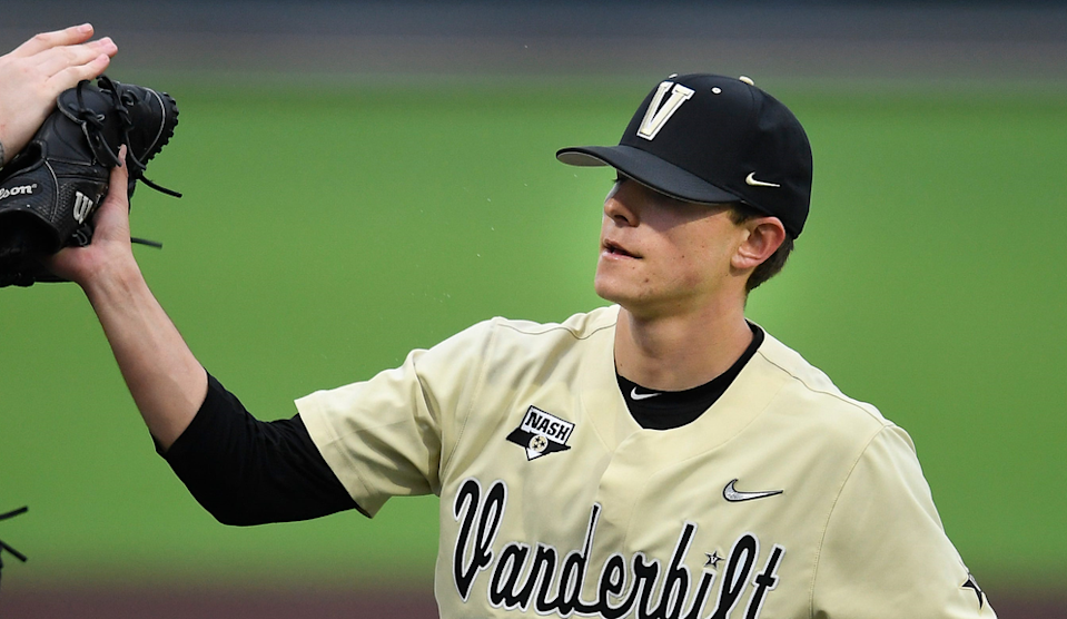 Vanderbilt pitcher Tyler Brown and catcher CJ Rodriguez, left, congratulate freshman pitcher Jack Leiter (22) after he strike out all three South Alabama batters during the first inning at Hawkins Field Feb. 18, 2020. Nas Vandy Baseball Home Opener 019