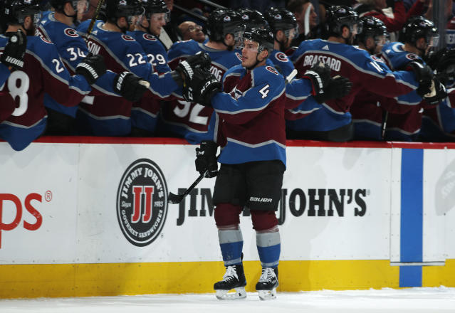 Colorado Avalanche defenseman Tyson Barrie is congratulated as he passes the team box after scoring a goal against the Edmonton Oilers in the second period of an NHL hockey game Tuesday, April 2, 2019, in Denver. (AP Photo/David Zalubowski)