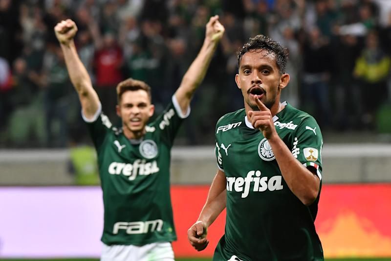 Gustavo Scarpa (L) of Brazil's Palmeiras celebrates after scoring against Argentina's Godoy Cruz during their Copa Libertadores football match at the Allianz Parque stadium in Sao Paulo, Brazil, on July 30, 2019. (Photo by Nelson ALMEIDA / AFP) (Photo credit should read NELSON ALMEIDA/AFP via Getty Images)