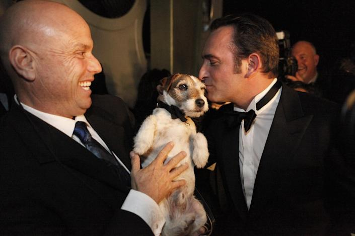 """2012: Jean Dujardin kisses Uggie, his canine co-star in """"The Artist"""""""