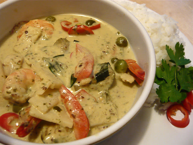 """<p><b>Thai Red/Green/Yellow curry with rice</b>: <br></p><p>Originating from Thailand, it is one of the most popular Thai dish, especially in India. Thai curries are coconut milk-based preparations with aromatic herbs and spicy powders. The Thai green curry is thicker and less spicy. Green colour is obtained from a paste of fresh green chilies and herbs, and red, as the colour suggests, is made from dried long red chilies combines with other herbs. Hence red curry is spicier. The yellow curry has the sweet-spicy paste based on <a href=""""http://www.templeofthai.com/cooking/ingredients.php"""" rel=""""nofollow noopener"""" target=""""_blank"""" data-ylk=""""slk:turmeric"""" class=""""link rapid-noclick-resp"""">turmeric</a> and <a href=""""http://www.templeofthai.com/food/spices/currypowder-3132042007.php"""" rel=""""nofollow noopener"""" target=""""_blank"""" data-ylk=""""slk:curry powder"""" class=""""link rapid-noclick-resp"""">curry powder</a>. These curries are mixed with coconut milk and then cooked with either steamed vegetables, chicken or fish. Steamed rice is an accompaniment with Thai curries. People usually combine Thai curries with Tom Kha soup that is a mild coconut soup.</p>"""