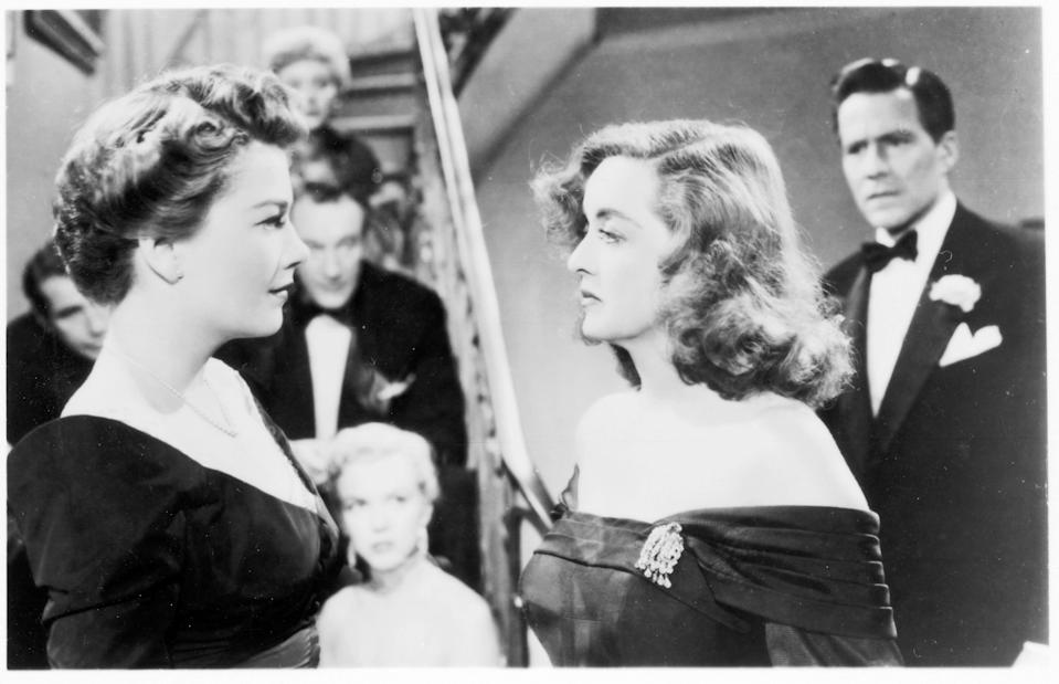 "An ambitious understudy (Anne Baxter, left) sets her sights on the stardom of a Broadway actress (Bette Davis) in ""All About Eve."""