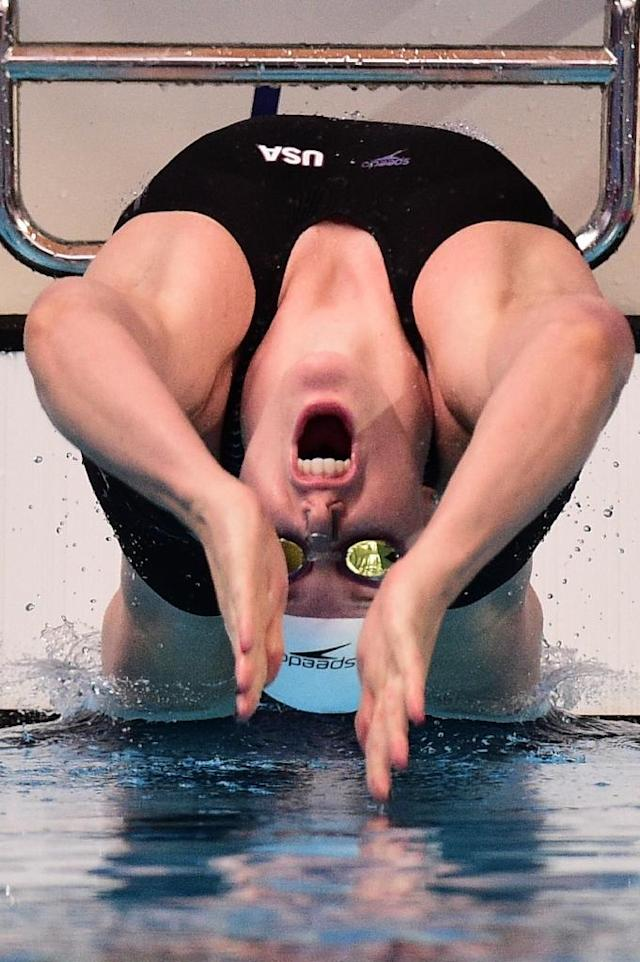 USA's Missy Franklin takes the start of a preliminary heat of the women's 100m backstrock swimming event at the 2015 FINA World Championships in Kazan on August 3, 2015 (AFP Photo/Martin Bureau)