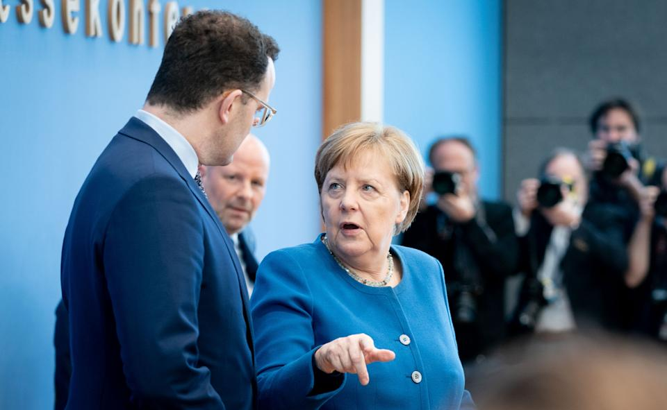 11 March 2020, Berlin: Chancellor Angela Merkel (CDU) and Jens Spahn (CDU), Federal Minister of Health, will hold a press conference on the development of the coronavirus. Photo: Kay Nietfeld/dpa (Photo by Kay Nietfeld/picture alliance via Getty Images)