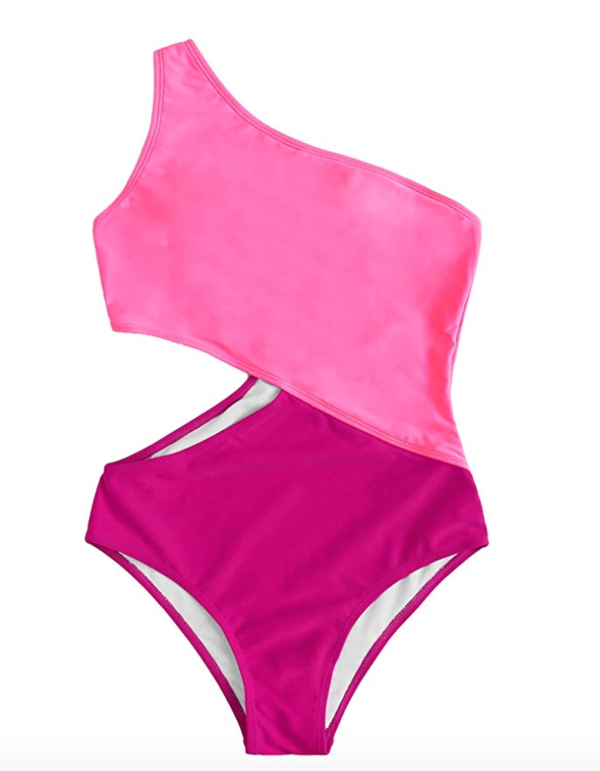 """<h2>One-Shoulder One-Piece Swimsuit </h2> <br>March, April, May, and most of June (tbh) were <a href=""""https://www.refinery29.com/en-us/best-matching-sweatsuits-womens"""" rel=""""nofollow noopener"""" target=""""_blank"""" data-ylk=""""slk:spent in loungewear"""" class=""""link rapid-noclick-resp"""">spent in loungewear</a> — but July is when readers finally leaned into the swimsuits-around-the-house attire. The top-performing suit of the month was this vibrant color-blocked, one-shoulder, and cutout one-piece style from our roundup on <a href=""""https://www.refinery29.com/en-us/best-swimsuits-amazon-2019"""" rel=""""nofollow noopener"""" target=""""_blank"""" data-ylk=""""slk:the best swimwear they'll never guess you snagged off Amazon"""" class=""""link rapid-noclick-resp"""">the best swimwear they'll never guess you snagged off Amazon</a> <br><br><em>Shop <strong><a href=""""https://amzn.to/3jP898x"""" rel=""""nofollow noopener"""" target=""""_blank"""" data-ylk=""""slk:Sweaty Rocks"""" class=""""link rapid-noclick-resp"""">Sweaty Rocks</a></strong></em><br><br><strong>SweatyRocks</strong> One Shoulder Cutout One Piece, $, available at <a href=""""https://amzn.to/32nXj0V"""" rel=""""nofollow noopener"""" target=""""_blank"""" data-ylk=""""slk:Amazon"""" class=""""link rapid-noclick-resp"""">Amazon</a><br><br><br>"""