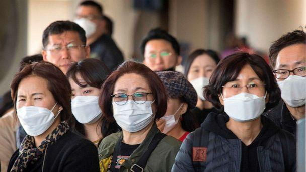 PHOTO: Passengers wear face masks as they arrive on a flight from Asia at Los Angeles International Airport on Jan. 29, 2020. (Mark Ralston/AFP via Getty Images)