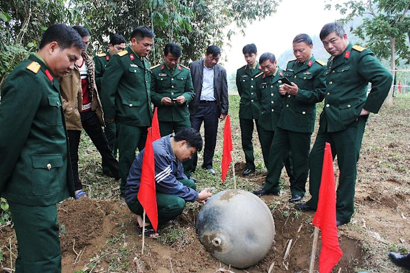 Vietnamese soldiers inspect a metal ball which landed in the northern province of Tuyen Quang (AFP Photo/)