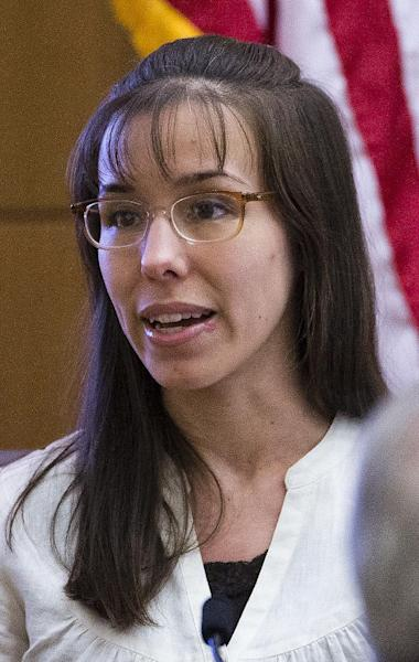 Jodi Arias answers written questions from the jury during her murder trial, Wednesday, March 6, 2013 in Maricopa County Superior Court in Phoenix. Arias is on trial for the 2008 murder of Travis Alexander. (AP Photo/The Arizona Republic, Tom Tingle, Pool)
