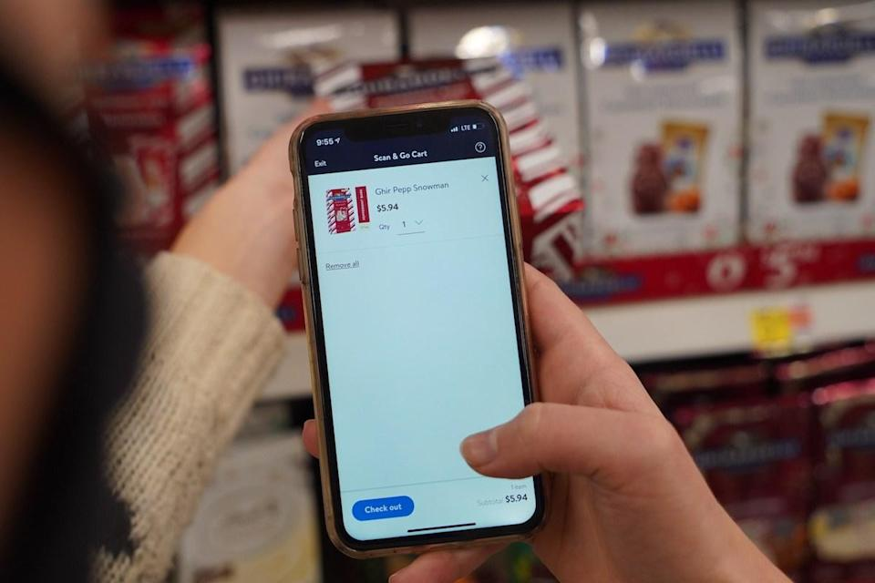 Customer Using Walmart+ Scan & Go