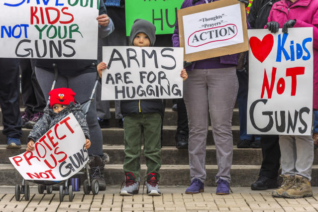 <p>Kanawha City Elementary school student Derrick Johnson, 5, and his brother David Johnson, 3 stand with others gathered on the steps of the Capitol building in Charleston, W.V.. (Craig Hudson/Charleston Gazette-Mail via AP) </p>