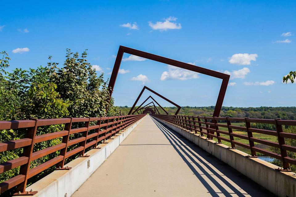 """<p><a href=""""https://www.inhf.org/what-we-do/protection/high-trestle-trail/"""" rel=""""nofollow noopener"""" target=""""_blank"""" data-ylk=""""slk:High Trestle Trail"""" class=""""link rapid-noclick-resp"""">High Trestle Trail</a> is a 25-mile trek that crosses through through three counties in central Iowa! This awesome trail is perfect for any workout buff that wants to get some good cardio in on their next staycation, whether on foot or two wheels. If food and drinks are more your thing, make the short trip to Des Moines to try out the Asian-inflected eats at <a href=""""https://www.harbingerdsm.com/"""" rel=""""nofollow noopener"""" target=""""_blank"""" data-ylk=""""slk:Harbinger"""" class=""""link rapid-noclick-resp"""">Harbinger</a>, followed by the killer cocktail lineup at <a href=""""https://hellomarjorie.com"""" rel=""""nofollow noopener"""" target=""""_blank"""" data-ylk=""""slk:Hello, Majorie"""" class=""""link rapid-noclick-resp"""">Hello, Majorie</a>. It may not constitute as an entire staycation, but it can change the rhythm of your routine. </p>"""