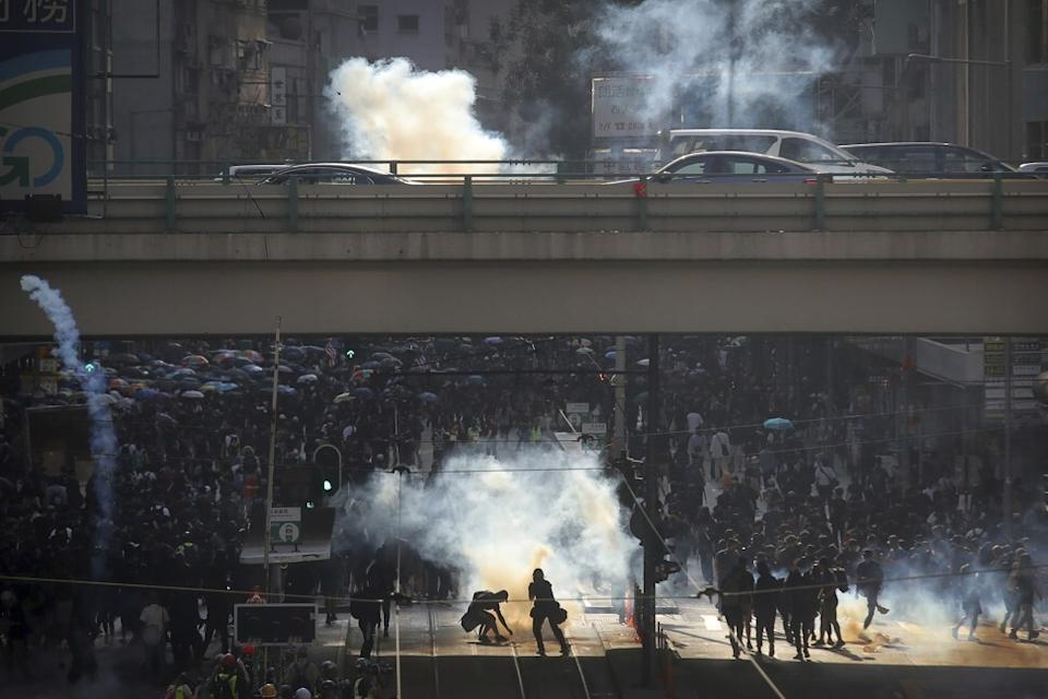 Demonstrators and police face off during a protest in Hong Kong in November 2019. Photo: AP
