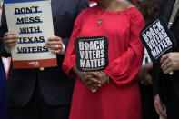 Democratic caucus members of the Texas House join a rally on the steps of the Texas Capitol to support voting rights, Thursday, July 8, 2021, in Austin, Texas. (AP Photo/Eric Gay)