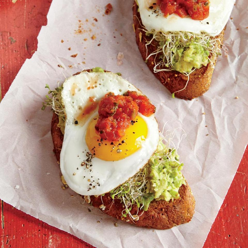 """<p>Sunny-side-up eggs, fresh sprouts, and <a href=""""https://www.myrecipes.com/news/we-tried-seven-brands-of-salsa-and-this-one-was-the-best"""" rel=""""nofollow noopener"""" target=""""_blank"""" data-ylk=""""slk:salsa"""" class=""""link rapid-noclick-resp"""">salsa</a> amp up avocado toast for a fast, no-fuss meal. It's a sure winner at breakfast, lunch, or dinner.</p>"""