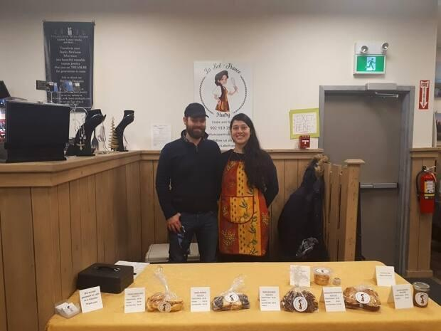 Elodie Nasone and her partner, Bart Pennewaert, are shown at their stall inside the Cape Breton Farmers' Market in Sydney. Due to COVID-19 restrictions, the regular Saturday market is now closed.