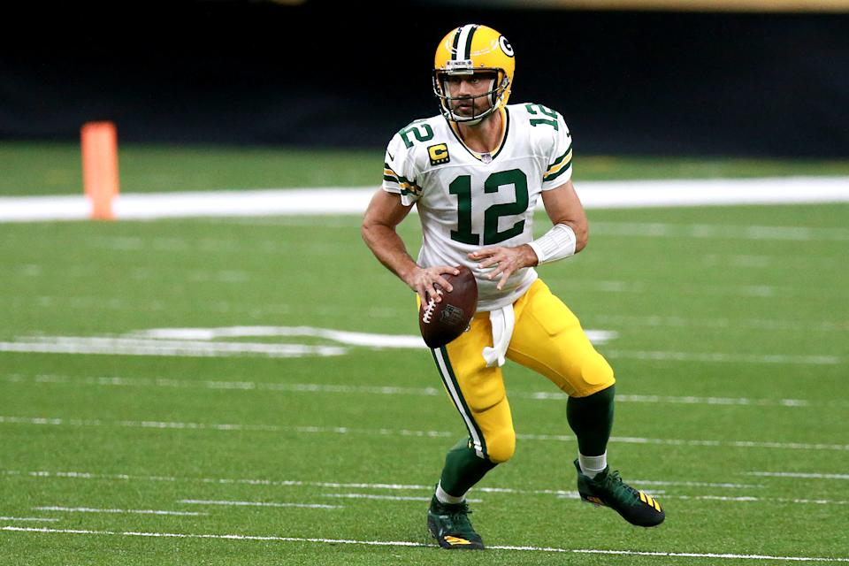 Aaron Rodgers looks to pass against the New Orleans Saints during the first half.