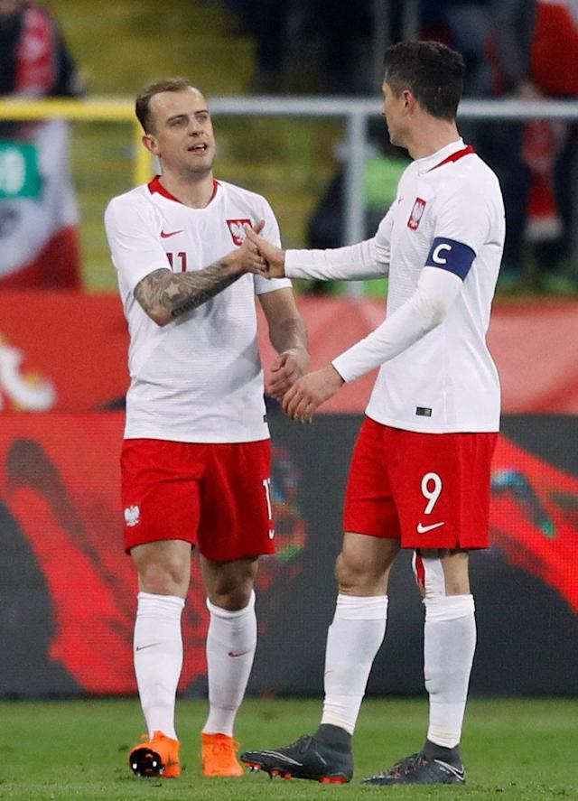Soccer Football - International Friendly - Poland vs South Korea - Silesian Stadium, Chorzow, Poland - March 27, 2018 Poland's Kamil Grosicki celebrates scoring their second goal with Robert Lewandowski REUTERS/Kacper Pempel
