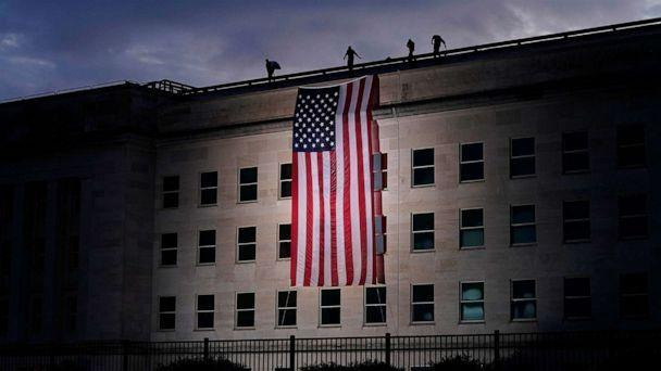 PHOTO: A large American flag is unfurled at the Pentagon ahead of ceremonies at the National 9/11 Pentagon Memorial to honor the 184 people killed in the 2001 terrorist attack on the Pentagon, in Washington, Sept. 11, 2020. (J. Scott Applewhite/AP)
