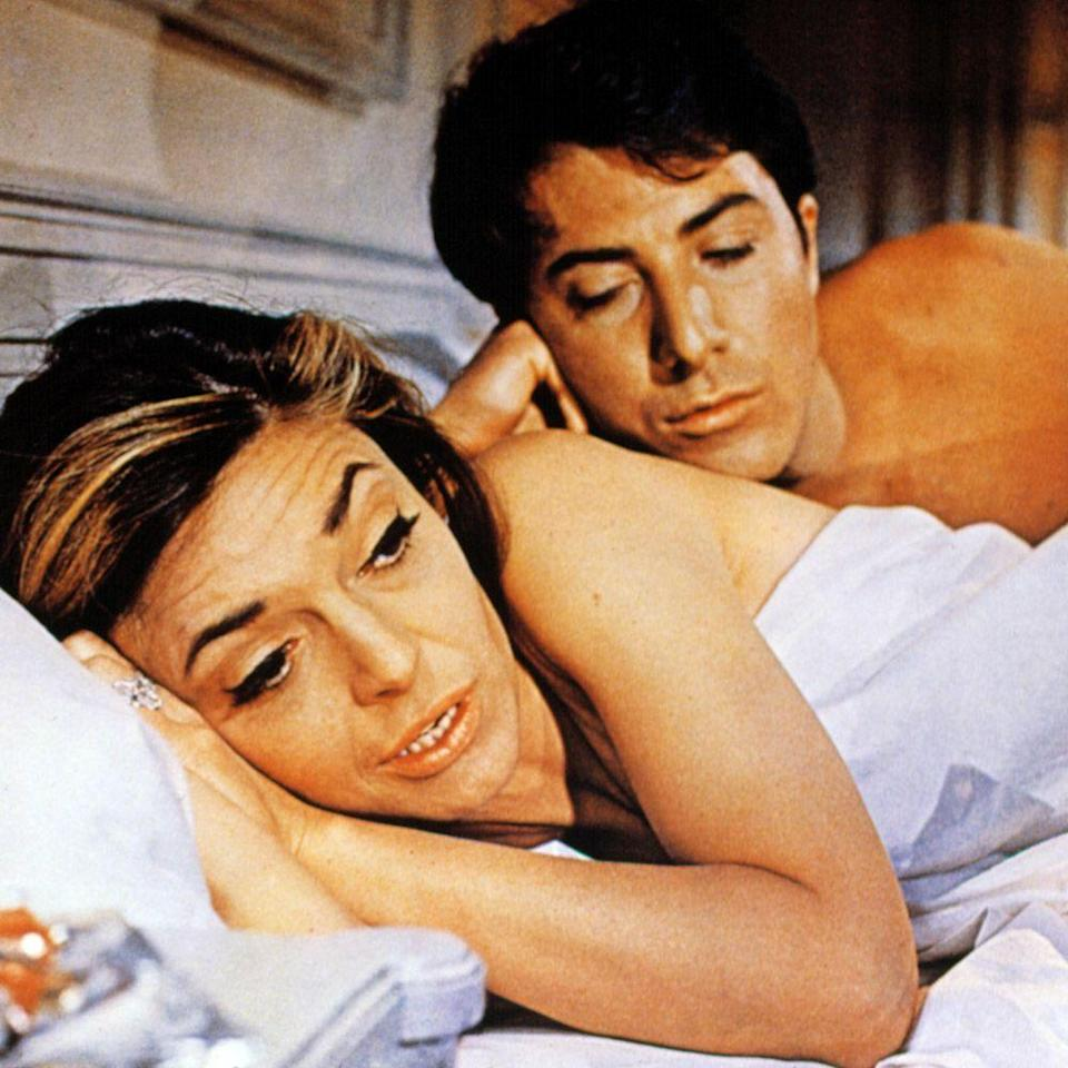"""<p>Mike Nichols enlisted Dustin Hoffman and Anne Bancroft to tell his story about a recent grad falling in lust with his girlfriend's mom. But also on the roll call were New York folk-pop duo Simon & Garfunkel, whose well-known interludes worked in perfect symbiosis with Nichols's affecting narrative. From """"<a href=""""https://www.youtube.com/watch?v=kDlAMjM-77Y"""" rel=""""nofollow noopener"""" target=""""_blank"""" data-ylk=""""slk:Mrs. Robinson"""" class=""""link rapid-noclick-resp"""">Mrs. Robinson</a>"""" to """"<a href=""""https://www.youtube.com/watch?v=ciERzSFRwzk"""" rel=""""nofollow noopener"""" target=""""_blank"""" data-ylk=""""slk:The Sound of Silence"""" class=""""link rapid-noclick-resp"""">The Sound of Silence</a>,"""" it's simply impossible to think of <em>The Graduate</em> without at least getting wistful over the film's melancholic sound that defined '60s youth.</p><p><a class=""""link rapid-noclick-resp"""" href=""""https://www.amazon.com/Graduate-Anne-Bancroft/dp/B002BPY2HE?tag=syn-yahoo-20&ascsubtag=%5Bartid%7C10056.g.32872244%5Bsrc%7Cyahoo-us"""" rel=""""nofollow noopener"""" target=""""_blank"""" data-ylk=""""slk:Watch and Listen"""">Watch and Listen</a></p>"""