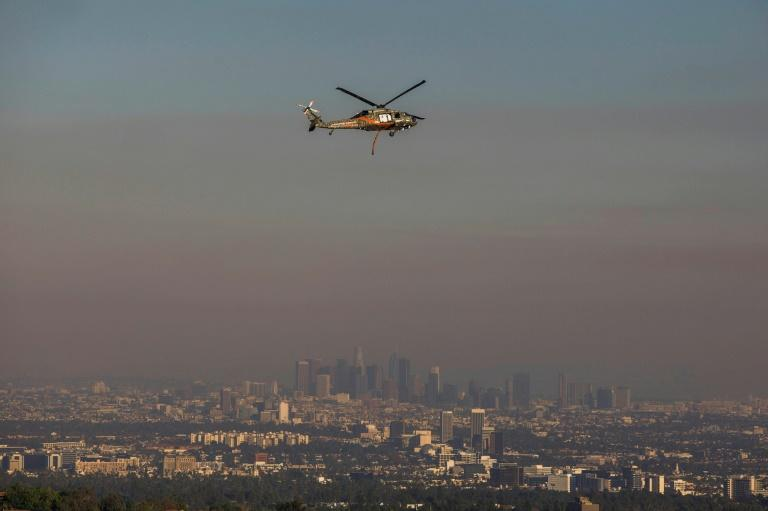 Emergency helicopters such as those used during wildfires are a frequent sight in the skies above Los Angeles (AFP Photo/Apu Gomes)