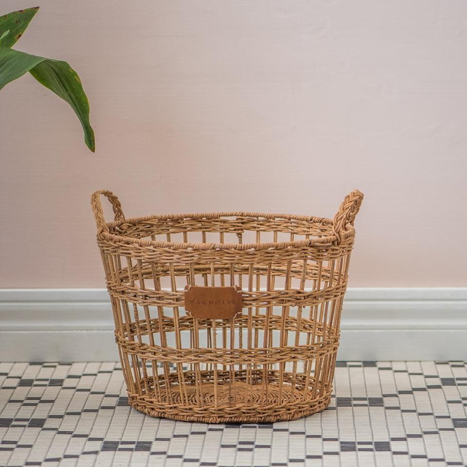 """<p>Available in two sizes, the <a href=""""https://www.popsugar.com/buy/Rattan-Open-Weave-Scarlett-Basket-488105?p_name=Rattan%20Open%20Weave%20Scarlett%20Basket&retailer=shop.magnolia.com&pid=488105&price=50&evar1=casa%3Aus&evar9=46582456&evar98=https%3A%2F%2Fwww.popsugar.com%2Fhome%2Fphoto-gallery%2F46582456%2Fimage%2F46582535%2FRattan-Open-Weave-Scarlett-Basket&list1=shopping%2Cdecor%20shopping%2C50%20under%20%2450%2Cjoanna%20gaines%2Chome%20shopping%2Cmagnolia%20home&prop13=api&pdata=1"""" rel=""""nofollow"""" data-shoppable-link=""""1"""" target=""""_blank"""" class=""""ga-track"""" data-ga-category=""""Related"""" data-ga-label=""""https://shop.magnolia.com/collections/organization/products/rattan-open-weave-scarlett-basket?variant=17183260966963"""" data-ga-action=""""In-Line Links"""">Rattan Open Weave Scarlett Basket</a> ($50) can store all of your pillows and throws with Magnolia style.</p>"""