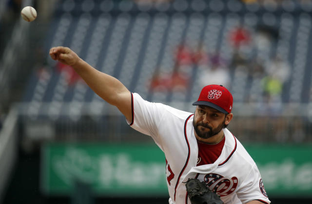 Washington Nationals starting pitcher Tanner Roark throws during the first inning of the first baseball game of a doubleheader against the Los Angeles Dodgers at Nationals Park, Saturday, May 19, 2018, in Washington. (AP Photo/Alex Brandon)