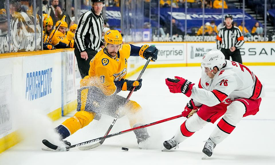 NASHVILLE, TN - MAY 10: Filip Forsberg #9 of the Nashville Predators skates against Vincent Trocheck #16 of the Carolina Hurricanes during the second period at Bridgestone Arena on May 10, 2021 in Nashville, Tennessee. (Photo by John Russell/NHLI via Getty Images)