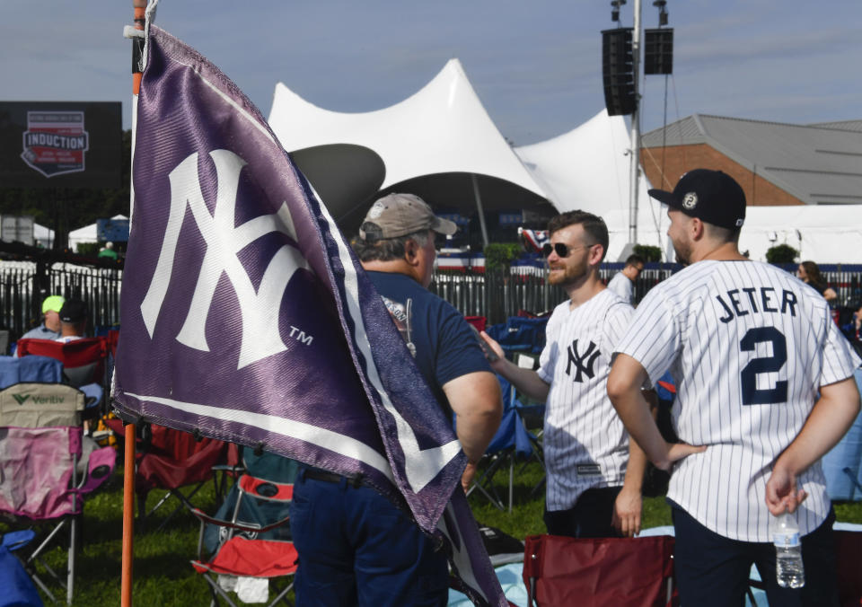 Fans attend the National Baseball Hall of Fame induction ceremony at the Clark Sports Center, Wednesday, Sept. 8, 2021, in Cooperstown, N.Y. (AP Photo/Hans Pennink)