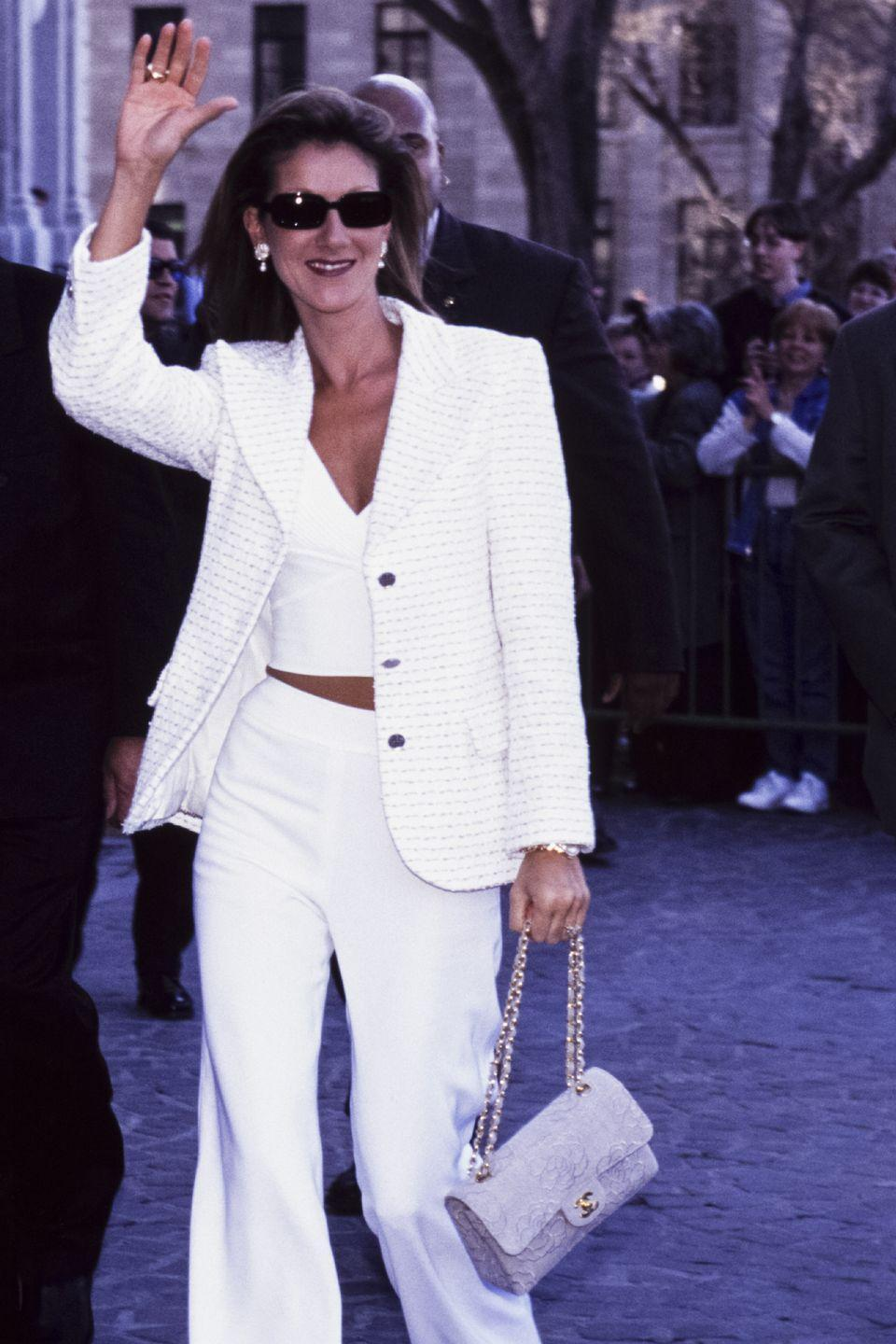 <p>While out in Québec, the singer looked incredibly chic in a white suit and crop top. She accessorized the look with a matching Chanel bag and pearl earrings. </p>