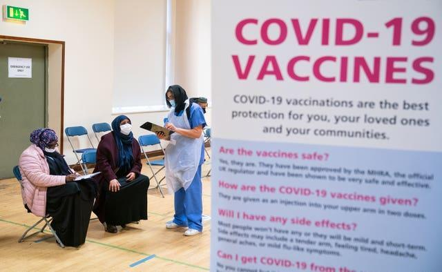 People attend a pop-up Covid-19 vaccination centre at the East London Mosque in Whitechapel