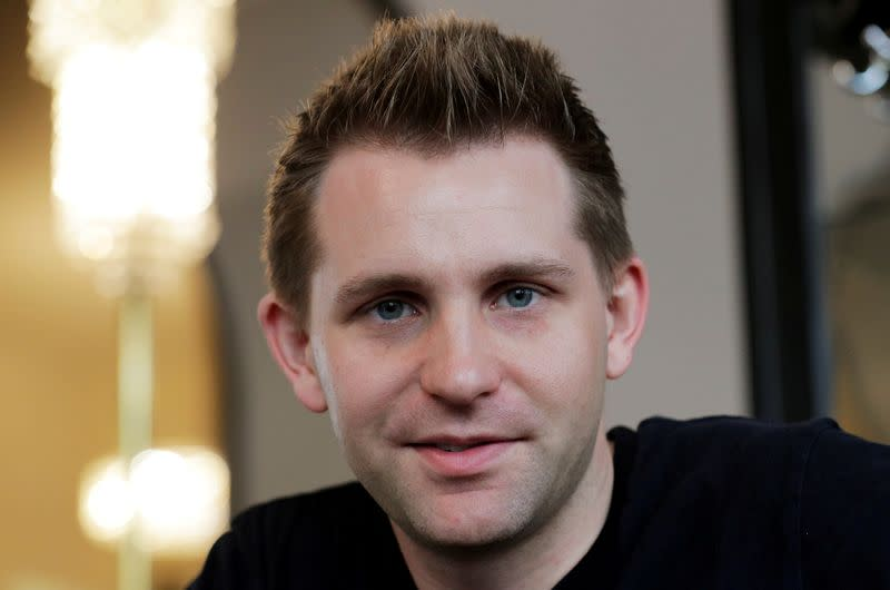 FILE PHOTO: Austrian lawyer and privacy activist Schrems smiles during a Reuters interview in Vienna