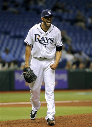 Tampa Bay Rays starting pitcher David Price reacts after striking out Kansas City Royals' Johnny Giavotella with a man on base to end the top of the eighth inning of a baseball game Tuesday, Aug. 21, 2012, in St. Petersburg, Fla. (AP Photo/Brian Blanco)