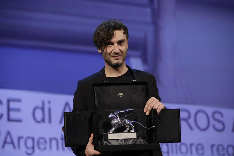 Director Alexandros Avranas holds the Silver Lion for Best Director for the film Miss Violence, during the awards ceremony of the 70th edition of the Venice Film Festival in Venice, Italy, Saturday, Sept. 7, 2013. (AP Photo/Domenico Stinellis)