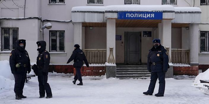 Russian police officers are seen outside a police station on January 18, 2021 in Khimki, outside Moscow, where opposition leader Alexei Navalny is held following his detention at a Moscow airport upon the arrival from Berlin. (Photo by Andrey BORODULIN / AFP) (Photo by ANDREY BORODULIN/AFP via Getty Images)