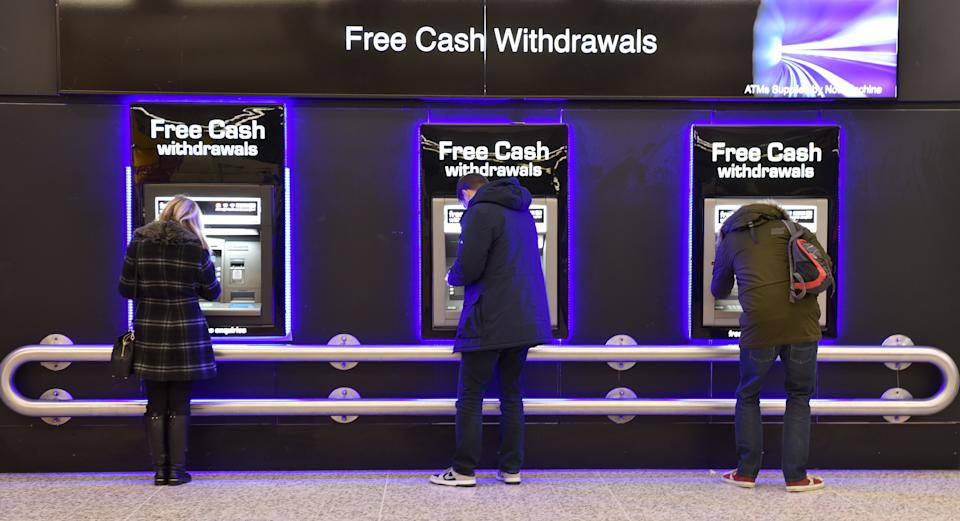 LONDON, ENGLAND - DECEMBER 16: People withdraw cash from free ATM cash machines on December 16, 2017 in London, England. (Photo by John Keeble/Getty Images)