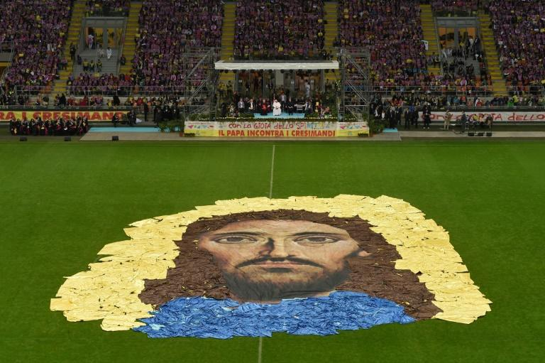 A portrait of Christ is represented on the football pitch of the stadium where young people rallied with octogenarian Pope Francis