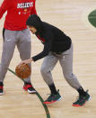 Atlanta Hawks guard Trae Young tests out the bone bruise in his right ankle two hours before tip off against the Milwaukee Bucks in Game 5 of the Eastern Conference finals in the NBA basketball playoffs Thursday, July 1, 2021, in Milwaukee. (Curtis Compton/Atlanta Journal-Constitution via AP)