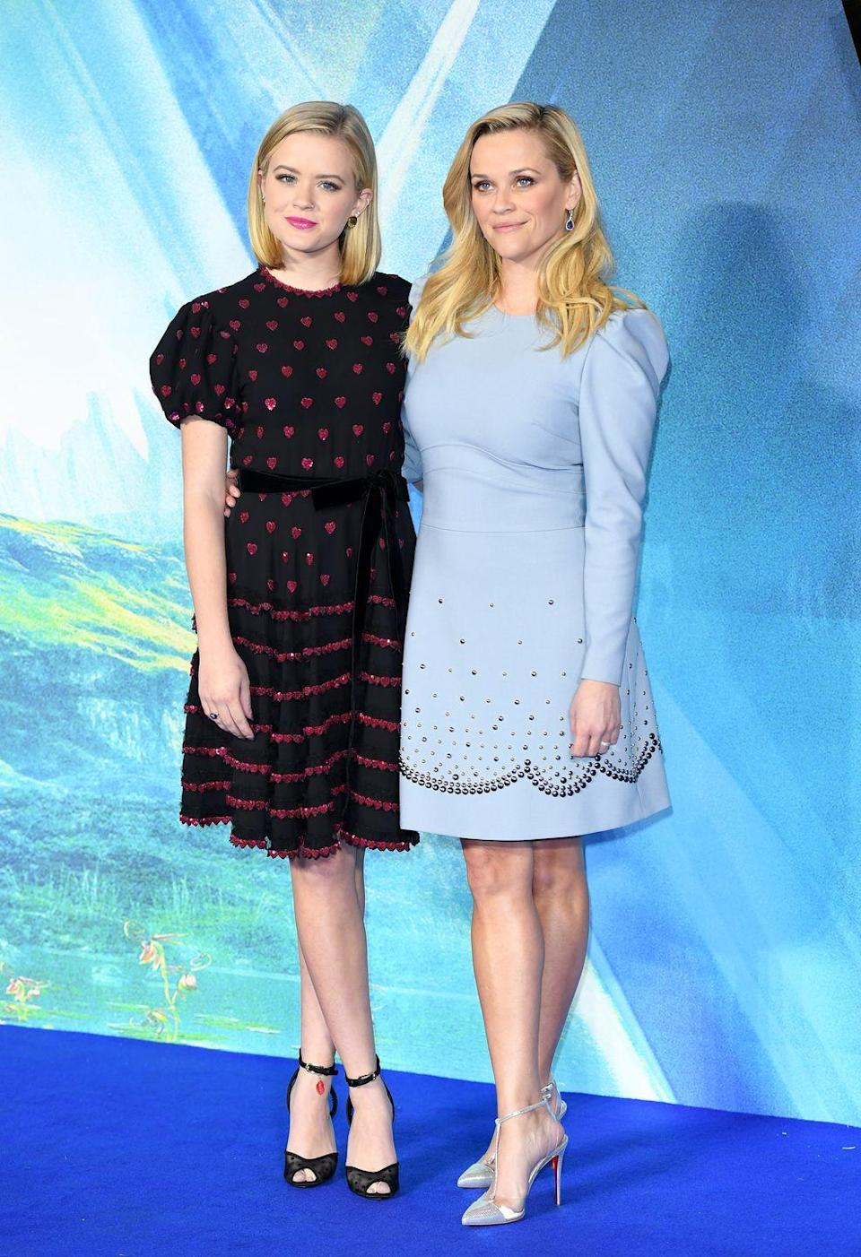 """<p>The mother-daughter duo posed on the blue carpet for the premiere of Reese's latest film, A Wrinkle In Time, in London. Reese wore Tiffany & Co.<span class=""""redactor-invisible-space""""> jewellery and an Elie Saab dress to the event. </span></p>"""