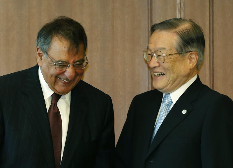 U.S. Secretary of Defense Leon Panetta, left, smiles with Japan's Defense Minister Satoshi Morimoto at the Ministry of Defense in Tokyo, Monday, Sept. 17, 2012. (AP Photo/Larry Downing, Pool)