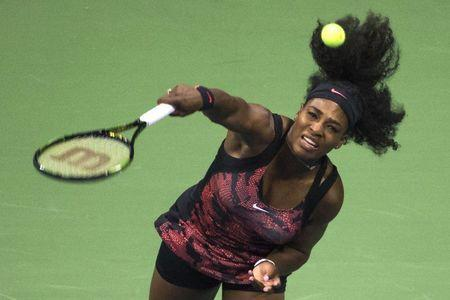 Serena Williams of the U.S. serves to Vitalia Diatchenko of Russia during their match at the U.S. Open Championships tennis tournament in New York, August 31, 2015. REUTERS/Adrees Latif