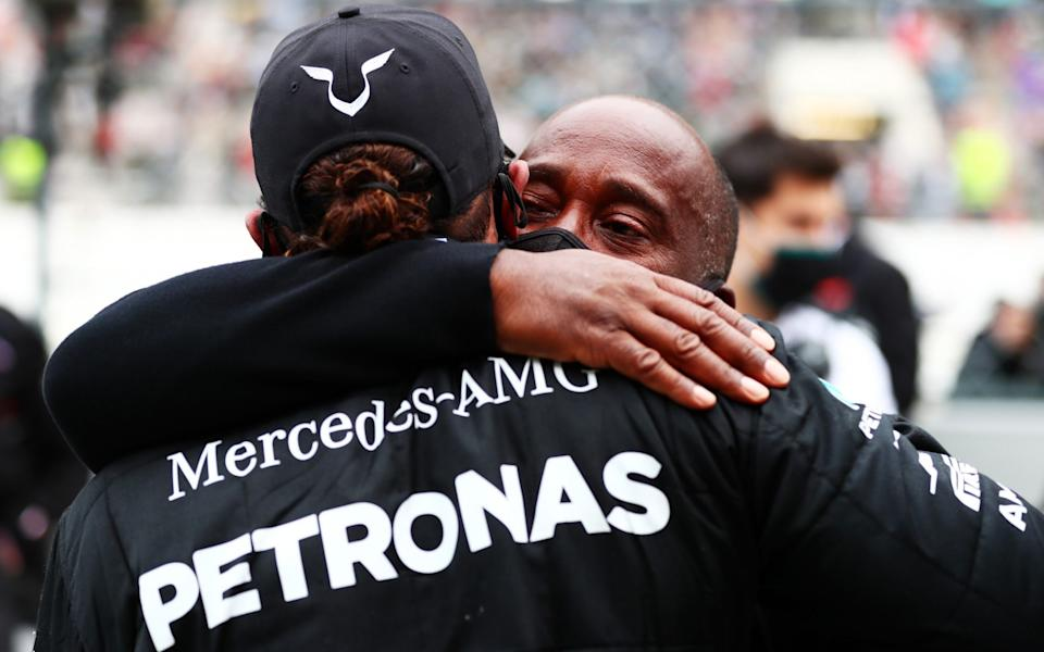 Race winner Lewis Hamilton of Great Britain and Mercedes GP celebrates his record breaking 92nd race win with his father Anthony Hamilton in parc ferme during the F1 Grand Prix of Portugal at Autodromo Internacional do Algarve on October 25, 2020 in Portimao, Portuga - Dan Istitene - Formula 1
