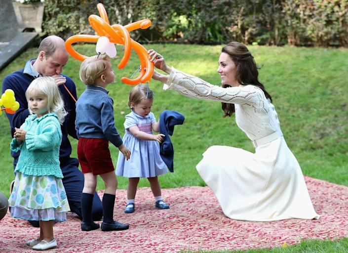 """<p>Prince George and his sister Charlotte <a href=""""https://www.townandcountrymag.com/society/tradition/a8023/princess-charlotte-balloons/"""" rel=""""nofollow noopener"""" target=""""_blank"""" data-ylk=""""slk:loved playing with the balloons"""" class=""""link rapid-noclick-resp"""">loved playing with the balloons</a> at a children's party for military families in Victoria. </p>"""