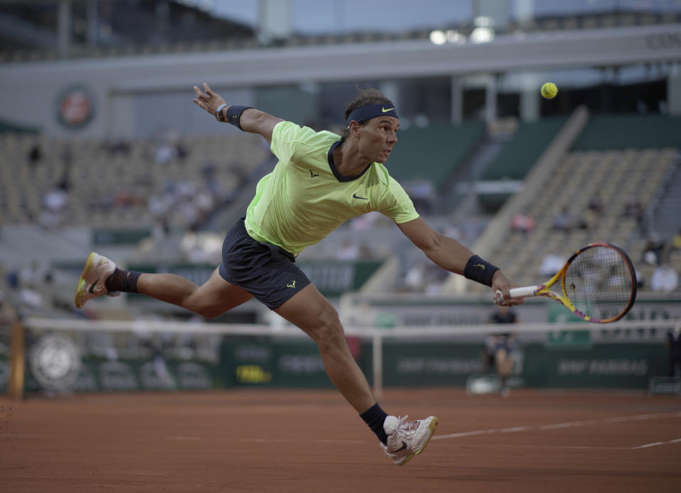 Spain's Rafael Nadal plays a return to Italy's Jannik Sinner during their fourth round match on day 9, of the French Open tennis tournament at Roland Garros in Paris, France, Monday, June 7, 2021.(AP Photo/Christophe Ena)