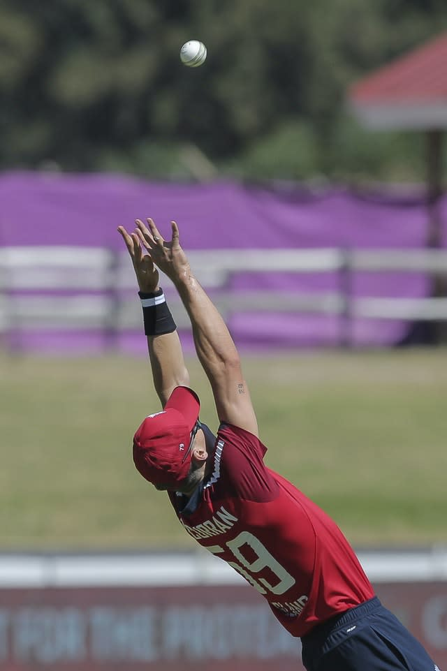 England fielder Tom Curran stretches to take the catch that dismissed Quinton De Kock during the tourists' Twenty20 victory in Paarl