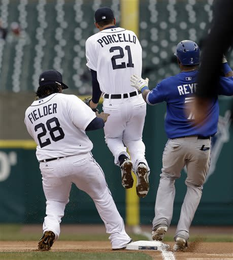 Detroit Tigers pitcher Rick Porcello jumps out of the way as first baseman Prince Fielder (28) steps on first base for the out on a grounder by Toronto Blue Jays' Jose Reyes during the first inning of a baseball game in Detroit, Wednesday, April 10, 2013. (AP Photo/Paul Sancya)