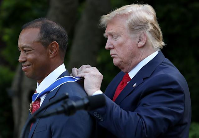 U.S. President Donald Trump presents professional golfer and business partner Tiger Woods with the Medal of Freedom during a ceremony in the Rose Garden at the White House May 06, 2019 in Washington, DC. Trump announced he would give the nation's highest civilian honor to Woods, 43, in honor of his Masters victory last month. (Photo by Win McNamee/Getty Images)