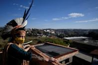 Angoho, an indigenous woman of the Pataxo Ha-ha-hae community, wears a face mask at the Vila Vitoria favela on the outskirts of Belo Horizonte, Brazil