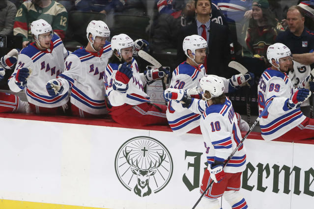 New York Rangers' Artemi Panarin, right, is congratulated by teammates after scoring a goal against the Minnesota Wild during the first period of an NHL hockey game Thursday, Feb. 13, 2020, in St. Paul, Minn. (AP Photo/Jim Mone)