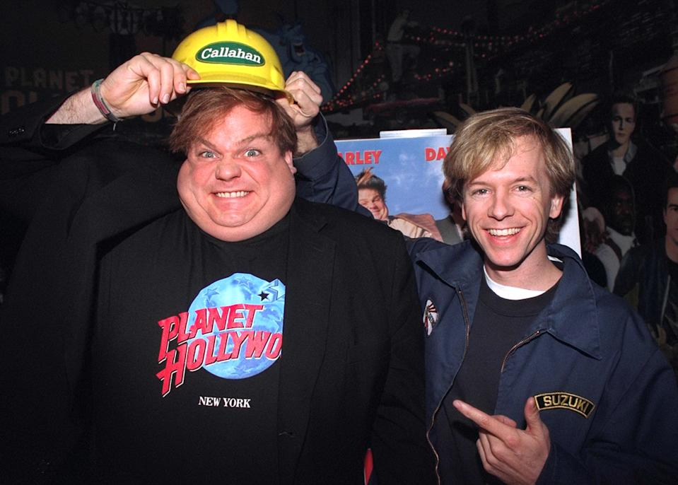 """UNITED STATES - MARCH 23:  Chris Farley (l.) and David Spade promoting their movie """"Tommy Boy"""" at Planet Hollywood.  (Photo by Richard Corkery/NY Daily News Archive via Getty Images)"""