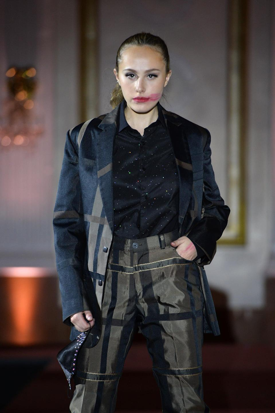 <p>Smeared red lipstick was featured on the hiTechMODA runway, which contrasted with the clean, simple face makeup that the model wore.</p>
